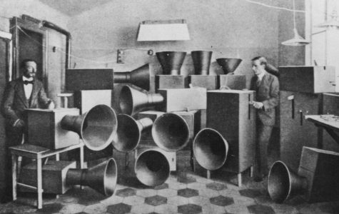 Luigi Russolo (1885 - 1947) the futurist artist with his assistant Piatti and the noise machine invented by him for futurist 'symphonies', one of which was performed at the London Coliseum in June 1914. He was also a painter.   (Photo by Hulton Archive/Getty Images)