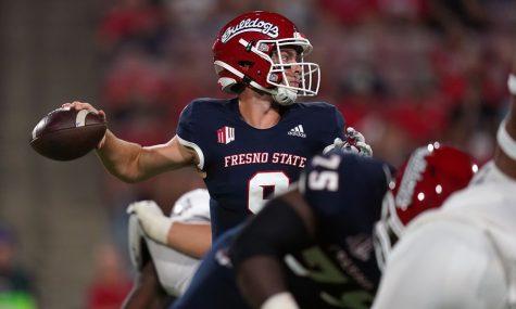 Sep 24, 2021; Fresno, California, USA; Fresno State Bulldogs quarterback Jake Haener (9) throws a pass against the UNLV Rebels in the second quarter at Bulldog Stadium. Mandatory Credit: Cary Edmondson-USA TODAY Sports